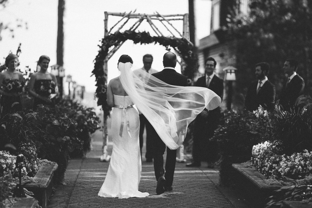 Black and white wedding ceremony photography at Grand View Lodge. Photo by Britt DeZeeuw, fine art photographer in Brainerd Minnesota.
