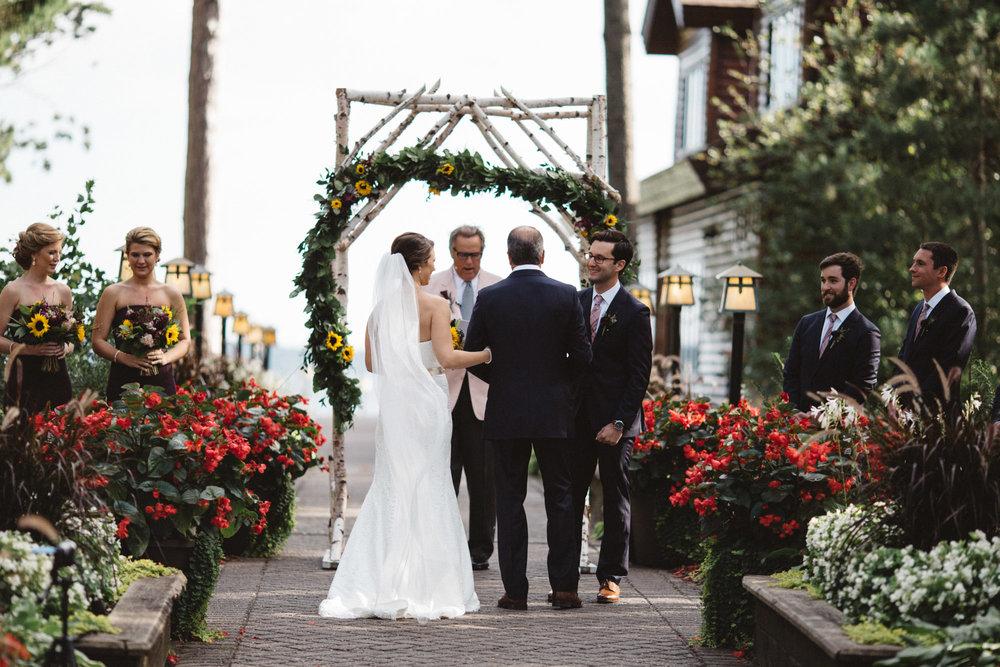 Lucious garden wedding ceremony at Grand View Lodge. Photography by Britt DeZeeuw, Brainerd Minnesota fine art photographer.