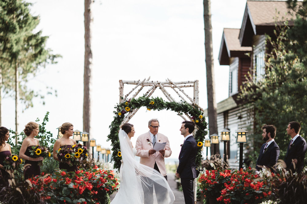 Stunning outdoor wedding ceremony at Grand View lodge on Gull Lake by Britt DeZeeuw Photography