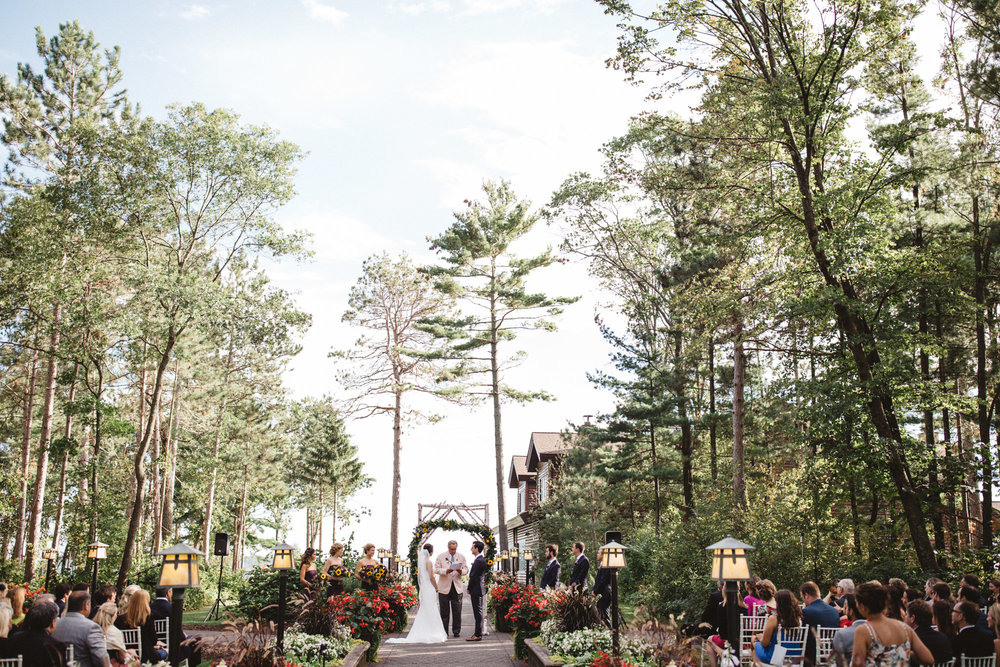 Epic outdoor wedding ceremony at Grand View Lodge on Gull lake by Britt DeZeeuw photography