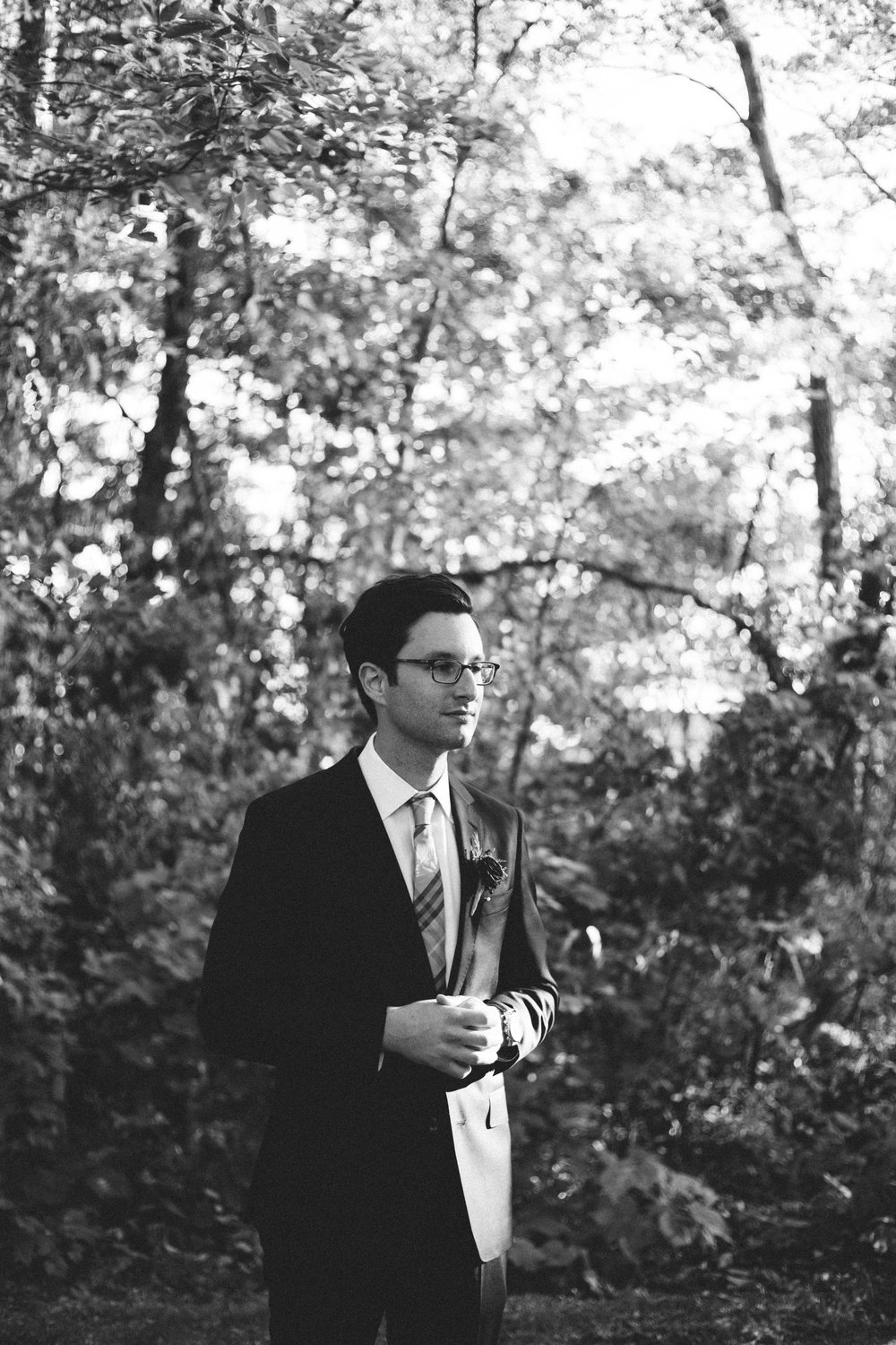 Timeless, black and white portrait of groom by Britt DeZeeuw photography, Grand View Lodge wedding photographer