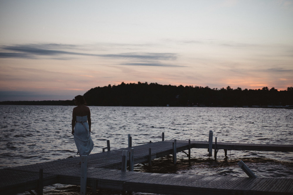 Artistic sunset wedding photography on Gull Lake at Grandview Lodge in Nisswa, Minnesota by Britt DeZeeuw. Elopement and destination photographer.