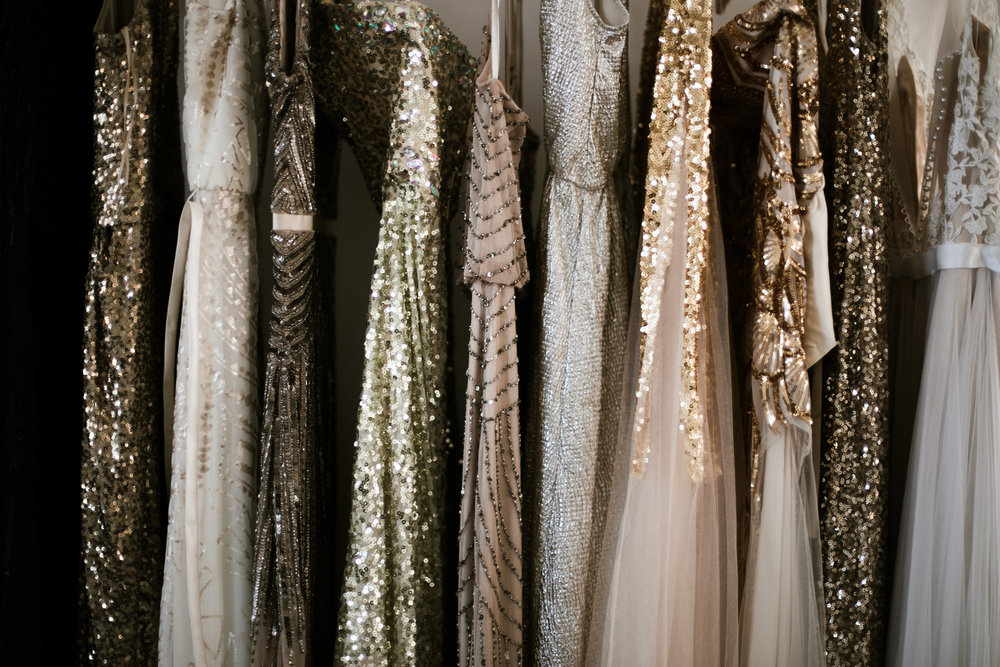 Sequin bridesmaids dresses hanging in the bridal suite of the NP Event Space. Wedding photography by Britt DeZeeuw.