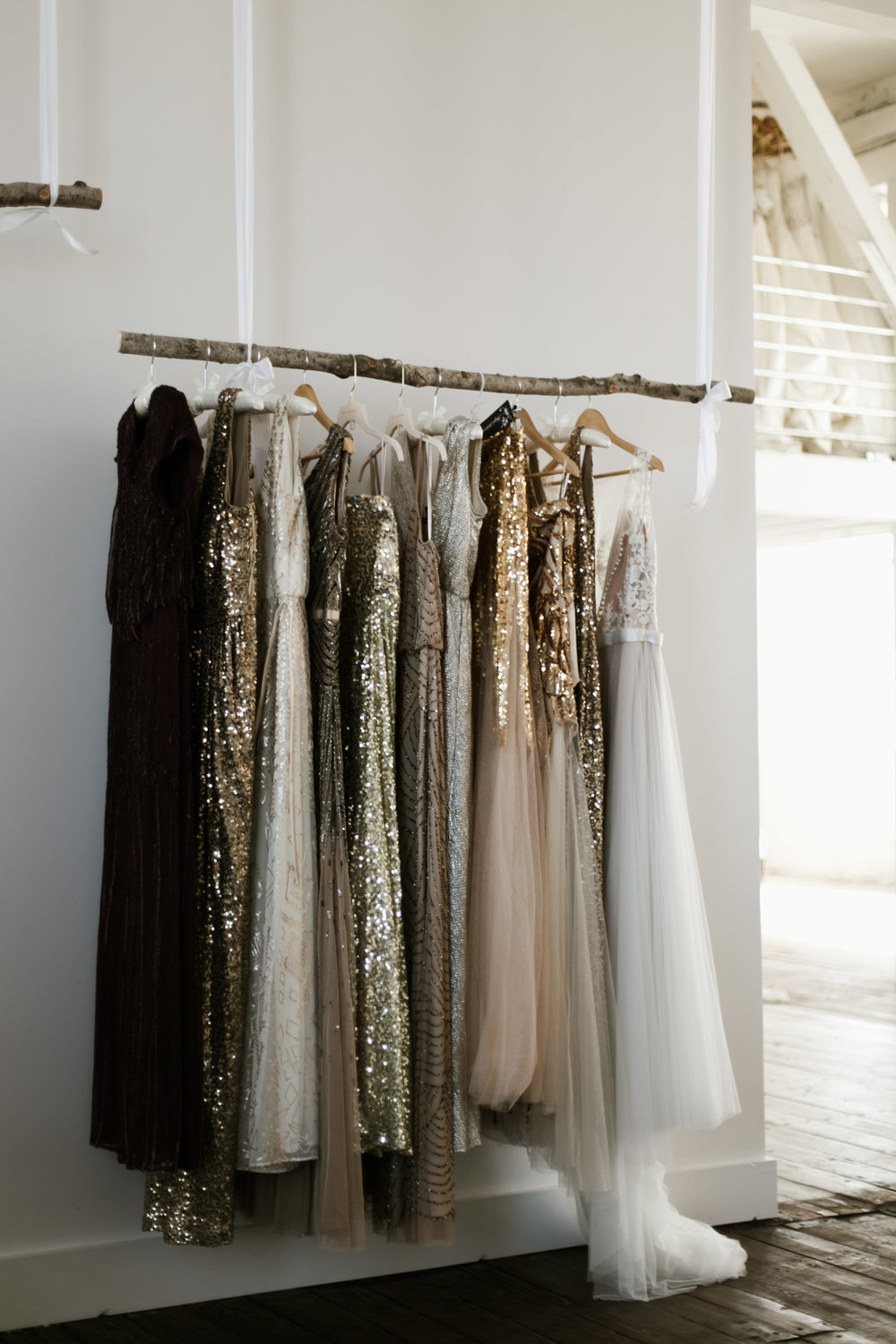 Metallic bridesmaids dressing hanging in the bridal suite at the NP Event Space. Photography by Britt DeZeeuw, Brainerd Minnesota wedding photographer.