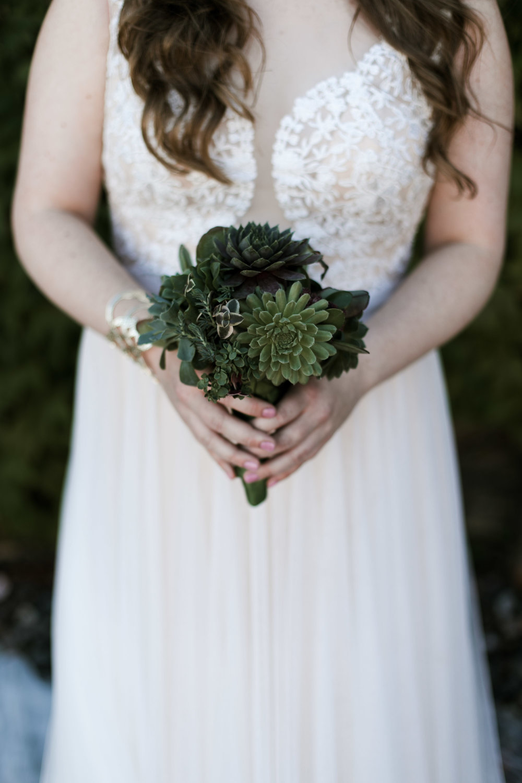Succulent bridal bouquet. Photography by Britt DeZeeuw, NP Event Space wedding photographer.