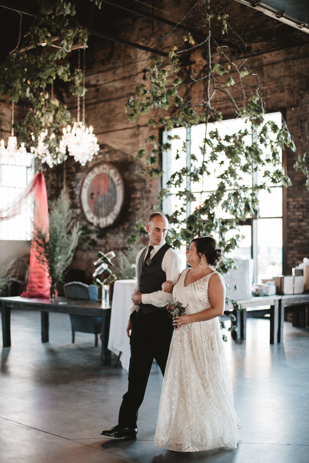 Eclectic industrial chic wedding ceremony at the NP Event Space. Photography by Britt DeZeeuw.