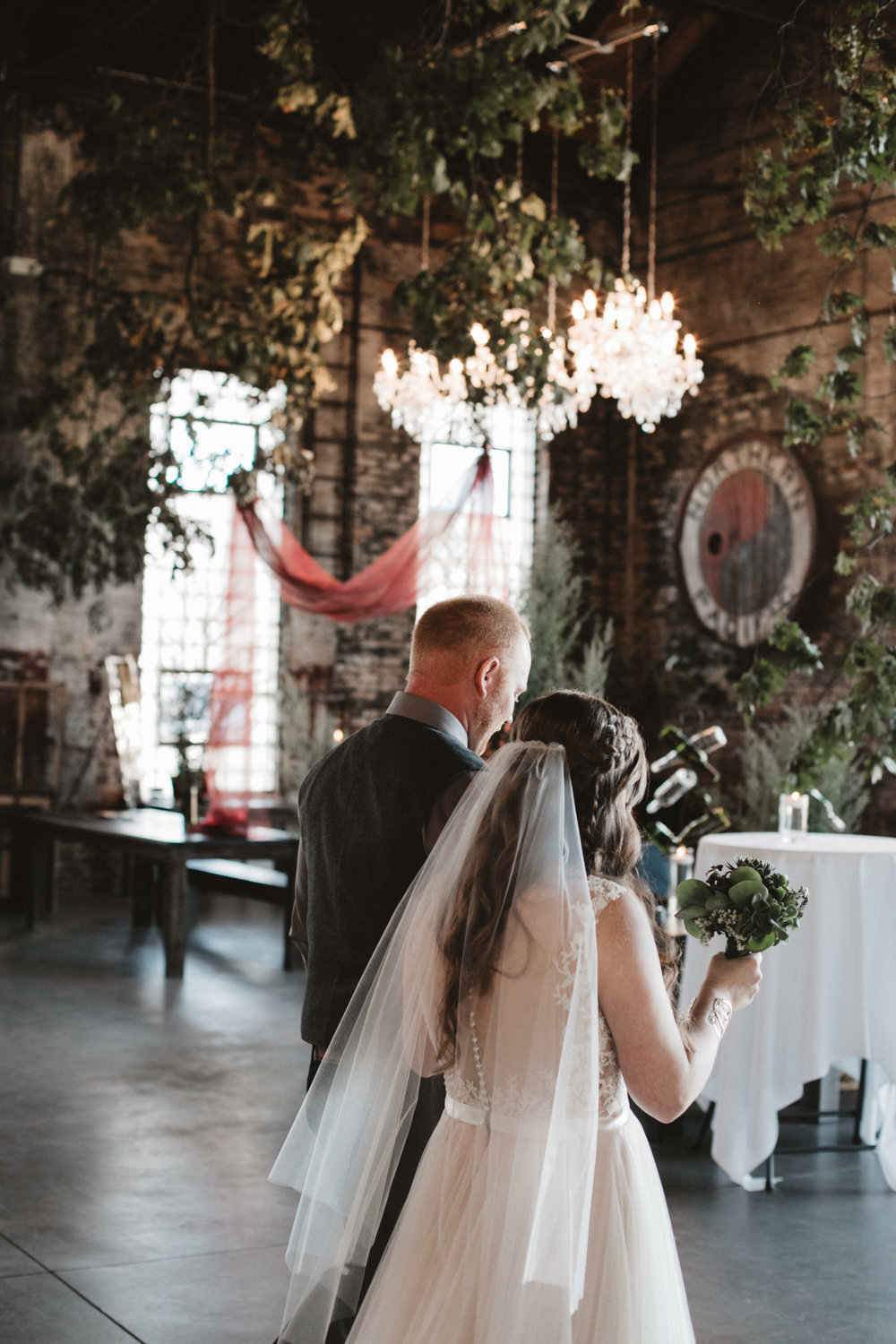 Indoor wedding ceremony at the NP Event Space. Photography by Britt DeZeeuw, natural light photographer.