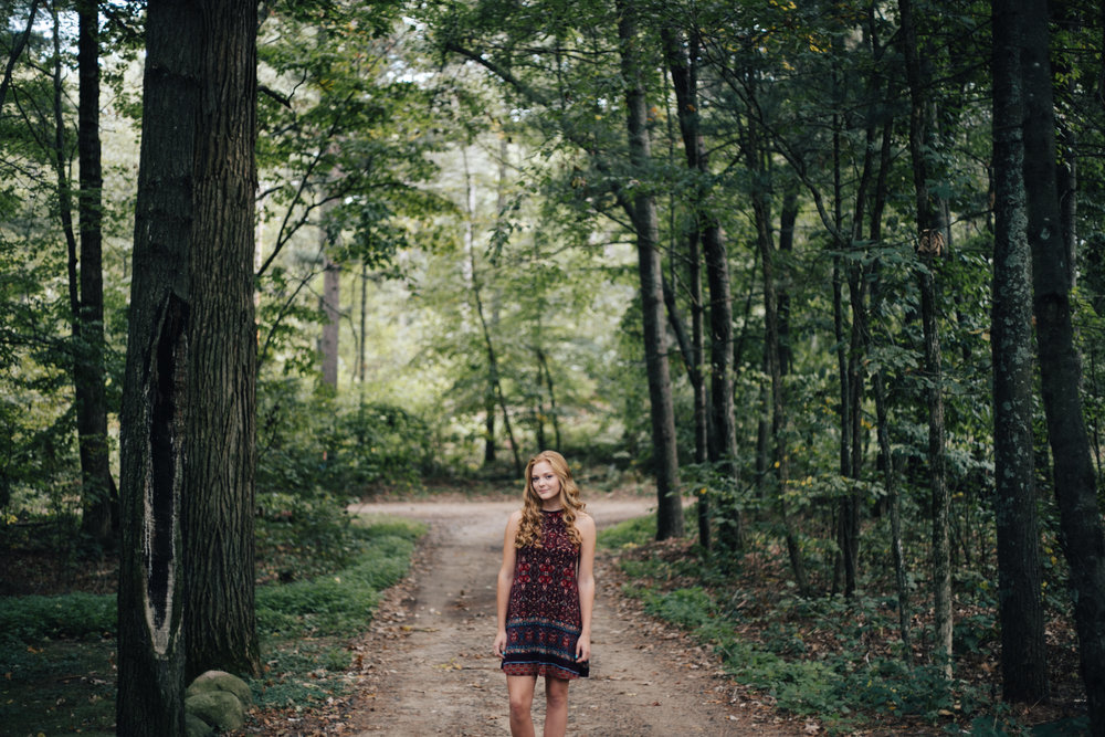 Creative portrait in the woods by Brainerd Minnesota high school senior photographer Britt DeZeeuw