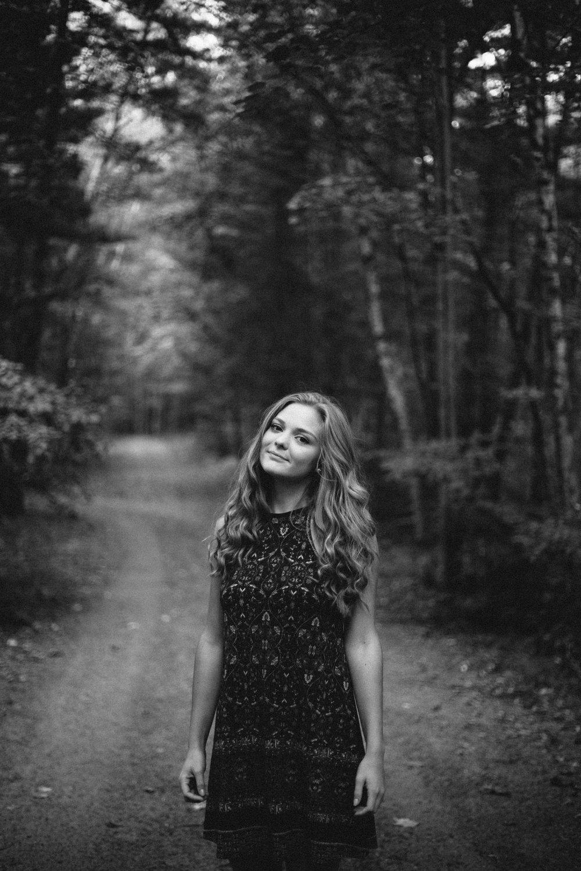 High school grad portrait session in the woods by Brainerd Minnesota senior photographer, Britt DeZeeuw