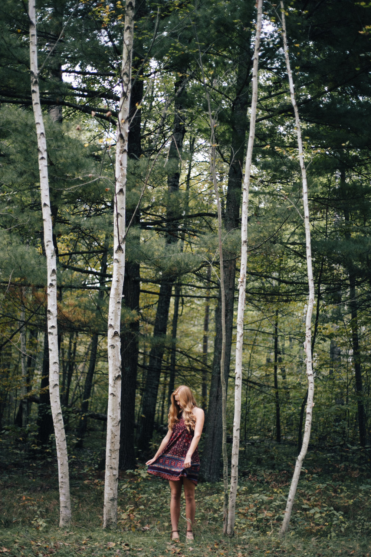 Untraditional high school senior portrait outdoors in the woods by Brainerd Minnesota photographer Britt DeZeeuw
