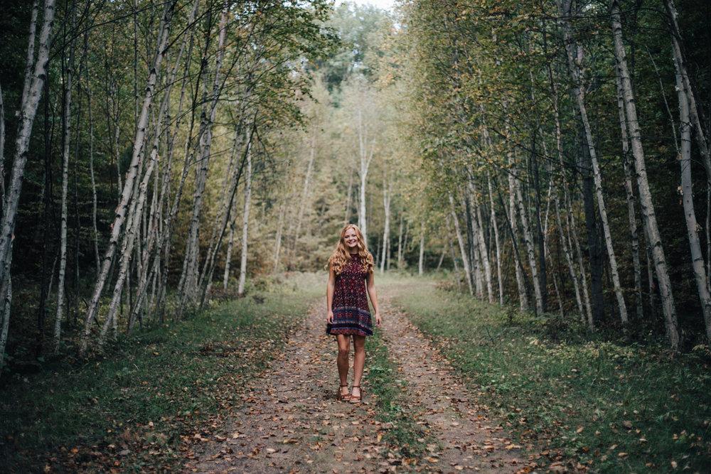 High school senior graduation portrait session in the woods captured by Brainerd MN photographer Britt DeZeeuw