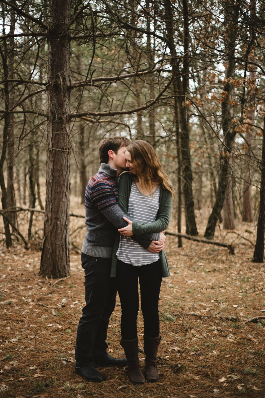 Engagement photography in the woods by Britt DeZeeuw, Brainerd Minnesota wedding photographer