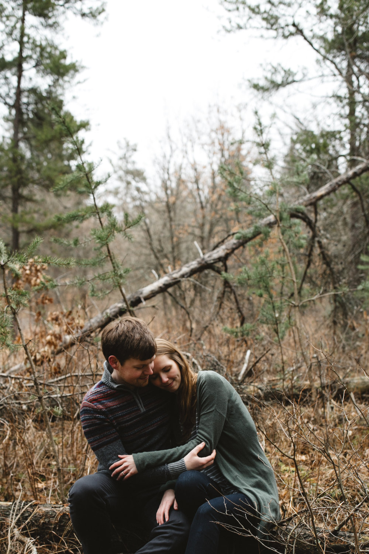 Romantic engagement session in the woods at the Northland Arboretum photographed by Britt DeZeeuw, Brainerd Minnesota wedding photographer