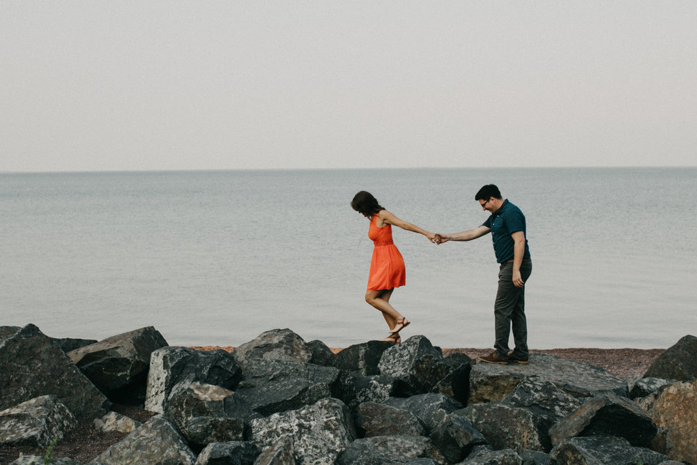 Canal Park beach engagement session photographed by Duluth wedding photographer, Britt DeZeeuw