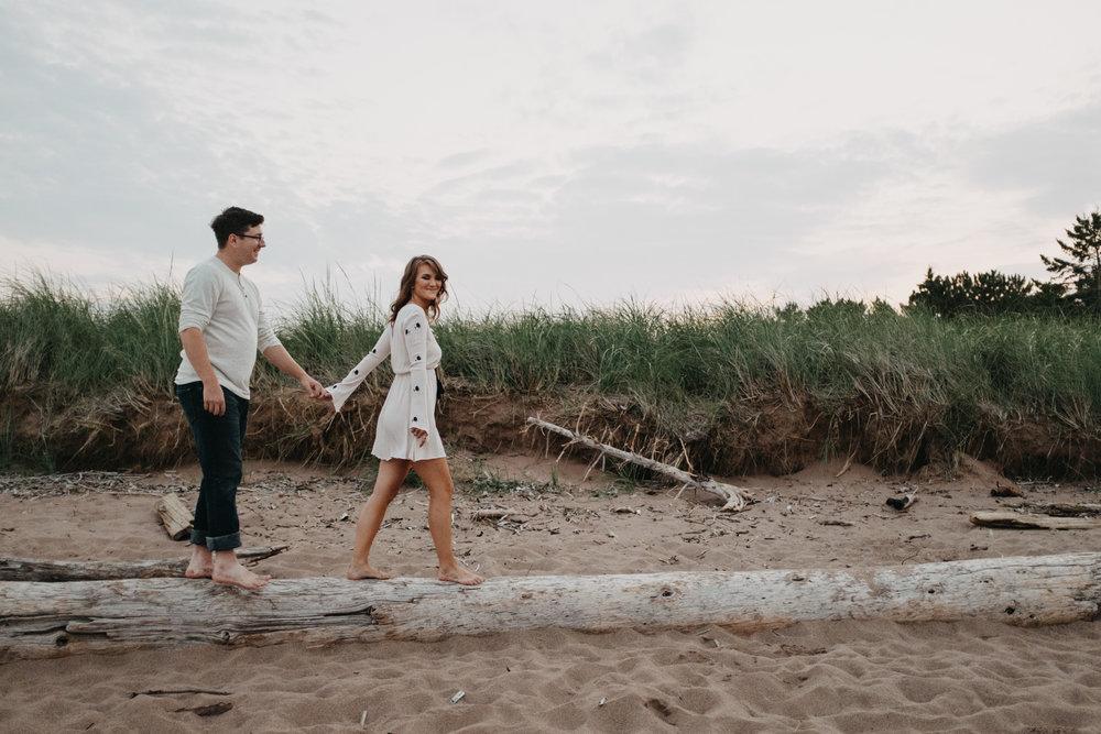 Park Point Beach Duluth Minnesota engagement session photographed by Britt DeZeeuw