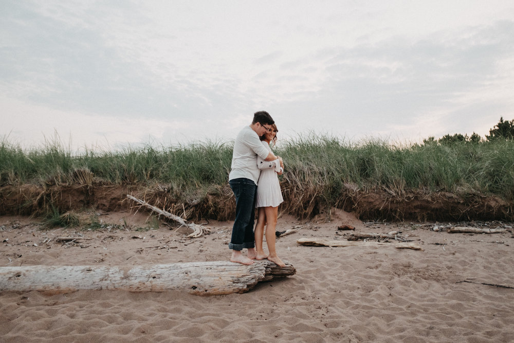Sand dune beach engagement session photographed by Britt DeZeeuw, Duluth Minnesota photographer