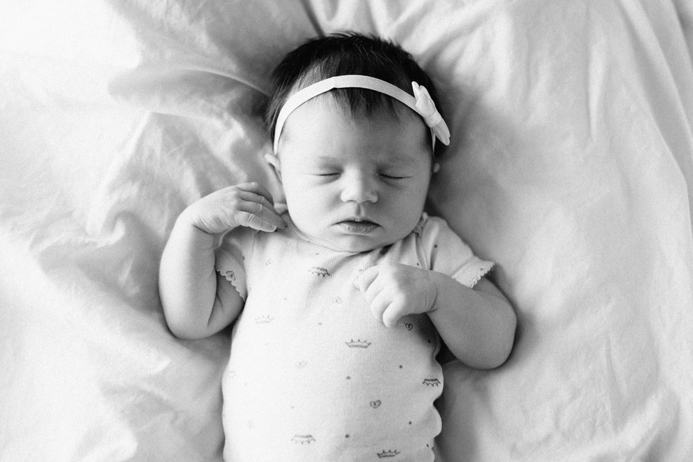 Black and white lifestyle newborn photography by Brained Minnesota photographer Britt DeZeeuw