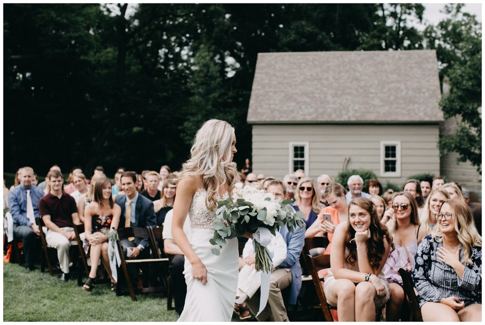 Documentary photography at outdoor Creekside Farm wedding ceremony by Britt DeZeeuw