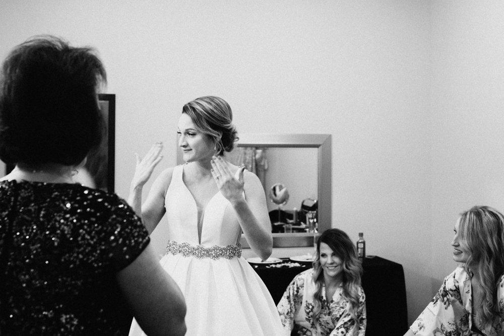 Emotional bride getting ready at Greysolon wedding in Duluth, Minnesota