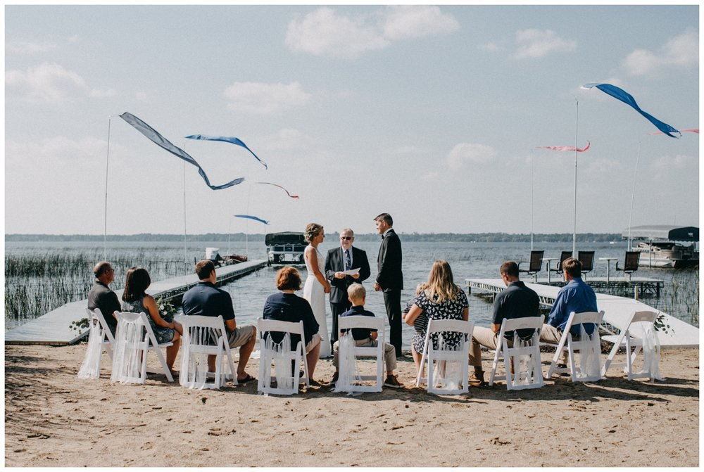 Intimate beach wedding ceremony on the lake in Brainerd Minnesota