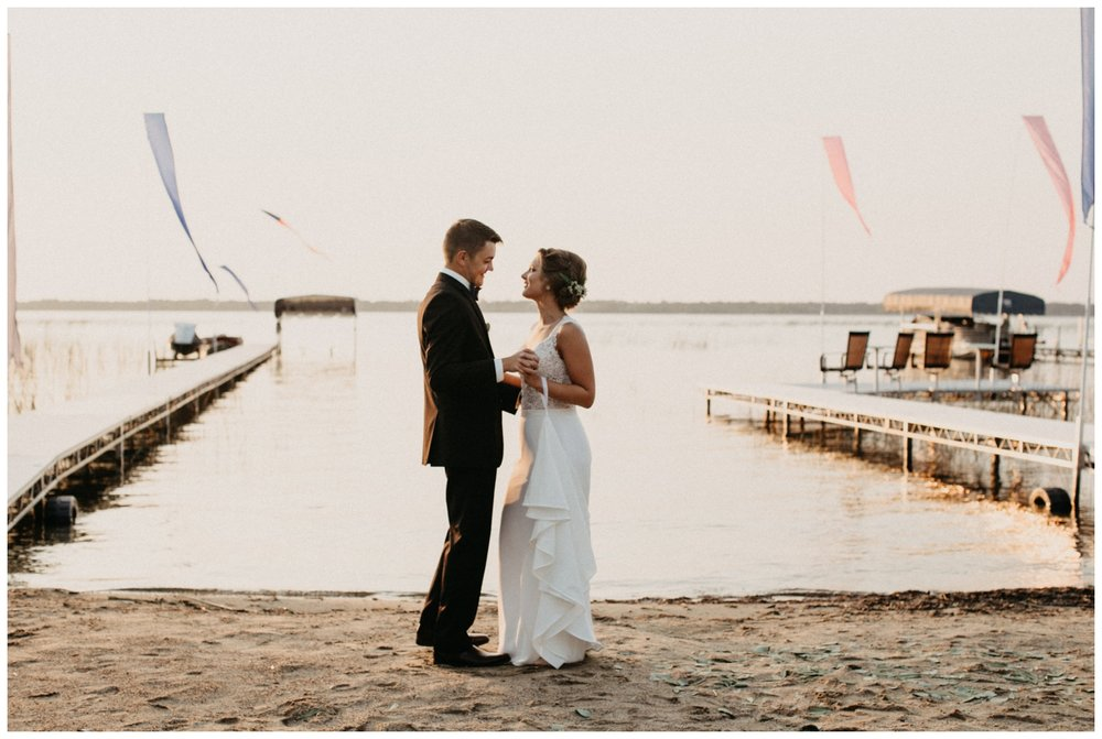 Sunset first dance at beach wedding on Lake Edward