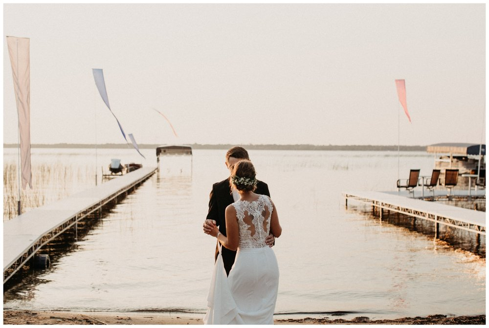 Bride and groom dancing on the beach at sunset at Lake Edward destination wedding