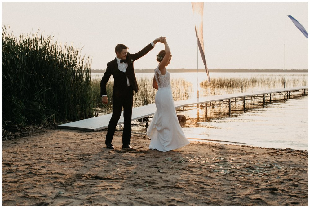 Beach wedding dance at sunset on Lake Edward