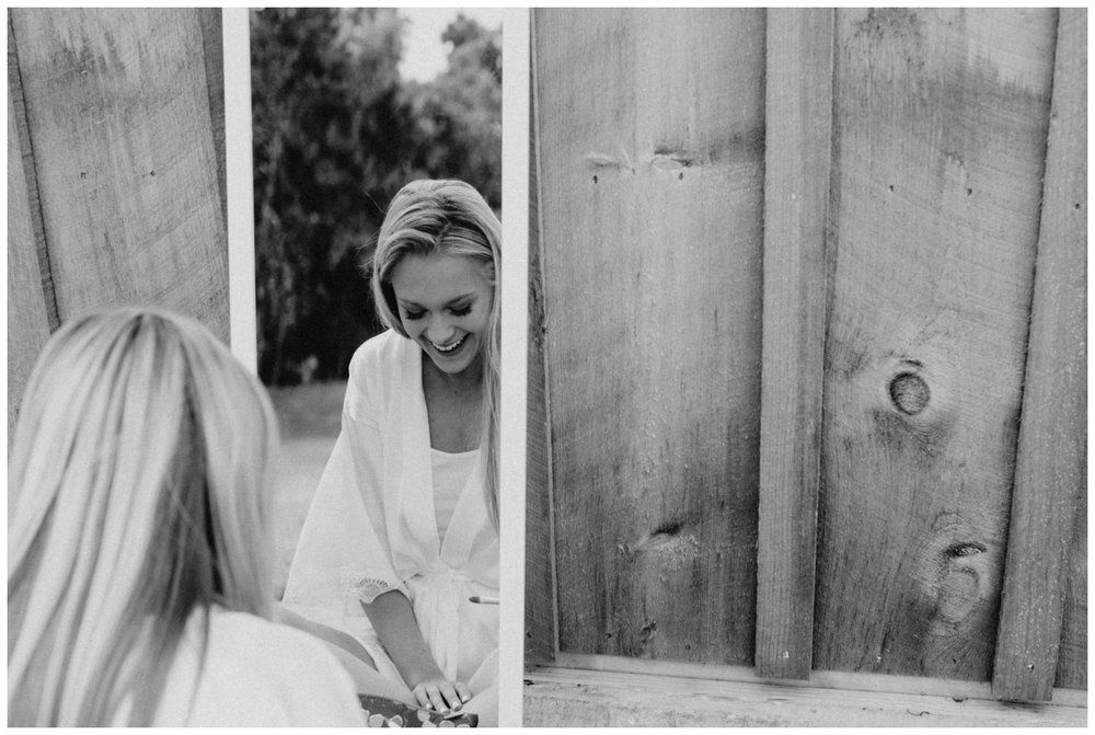 Bride getting ready at barn outside Creekside Farm wedding in Rush City Minnesota