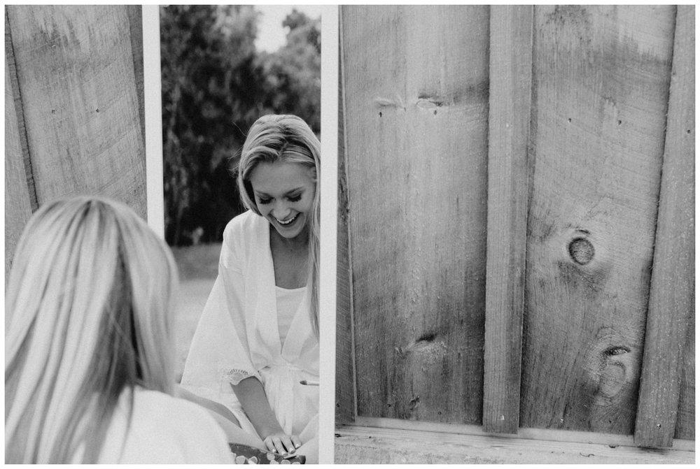 Bride getting ready at barn outside Creekside Farm wedding in Rush City Minnesota