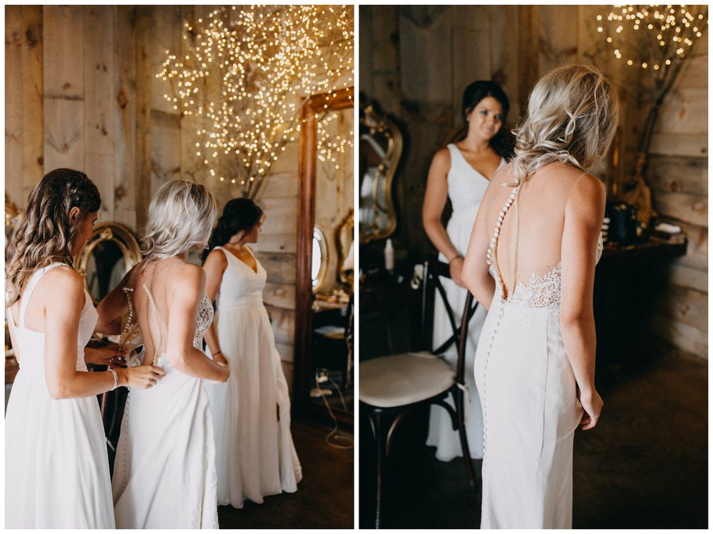 Bride getting into dress at Creekside Farm Wedding in Rush City, MN