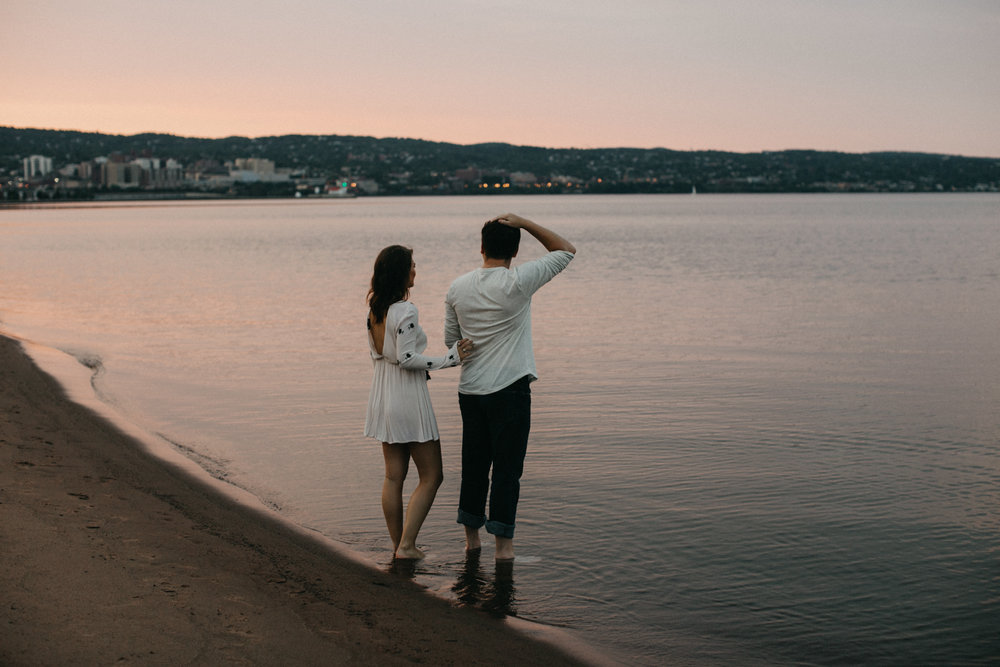 Park Point beach engagement session at sunset by Duluth, MN wedding photographer Britt DeZeeuw