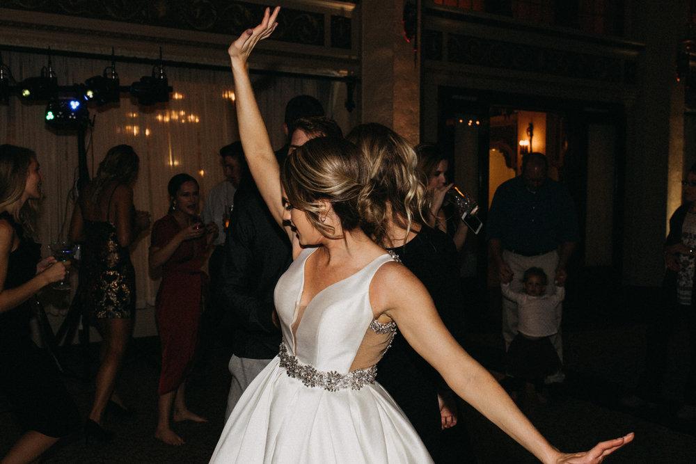 Bride dancing during wedding reception at the Greysolon in Duluth Minnesota by Britt DeZeeuw