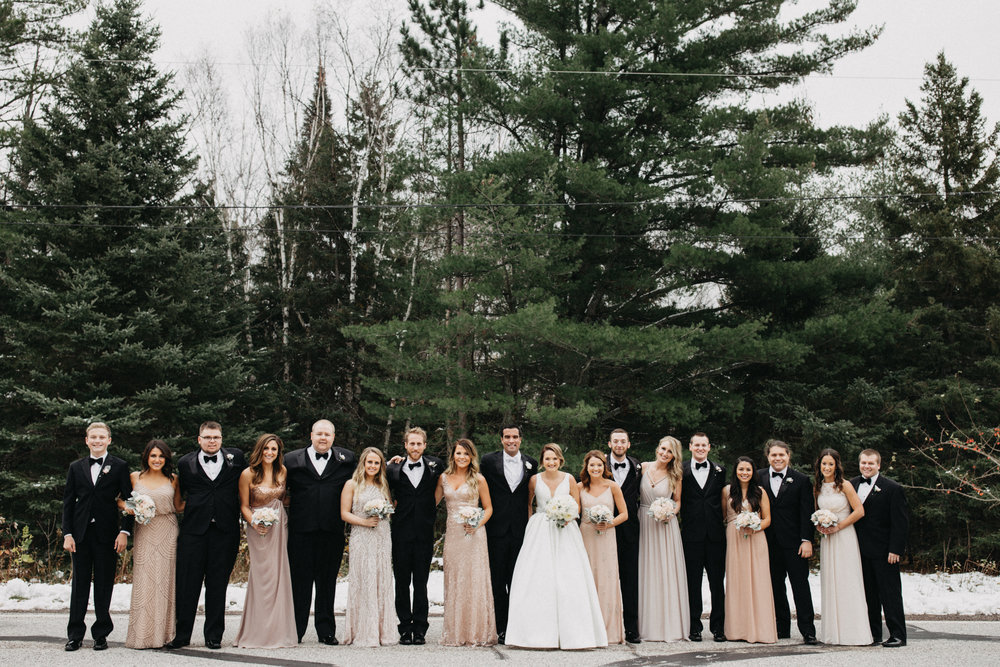 Wedding party candidly posed at Duluth Minnesota wedding