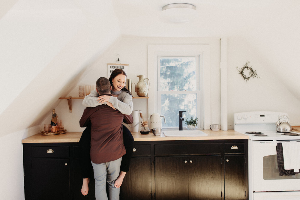 Candid in home engagement session photographed by Minneapolis wedding photographer Britt DeZeeuw
