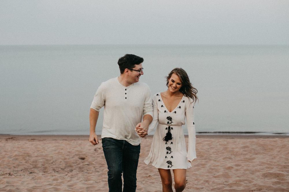 Park Point Beach engagement by Duluth wedding photographer Britt DeZeeuw