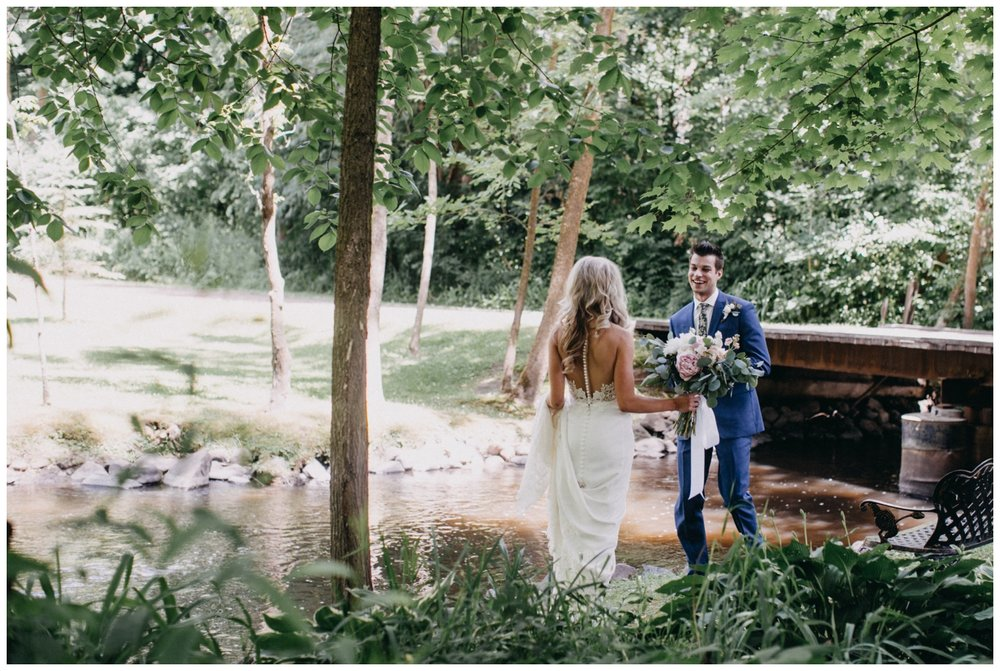 Emotional first look with bride and groom at Creekside Farm wedding photographed by Britt DeZeeuw