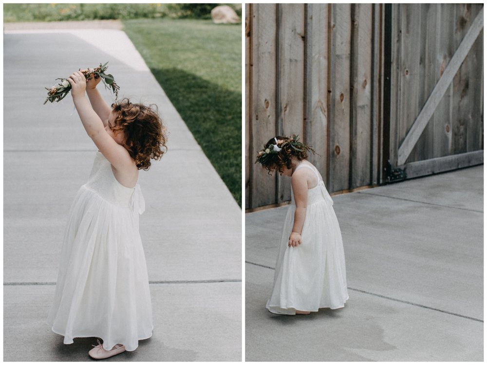 Flower girl in simple white dress with floral crown at Creekside Farm Wedding