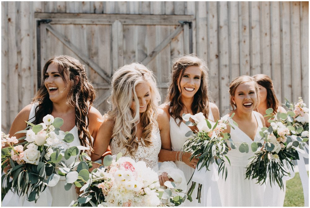 Gorgeous bride and bridesmaids at Creekside Farm wedding in Rush City, Minnesota photographed by Britt DeZeeuw