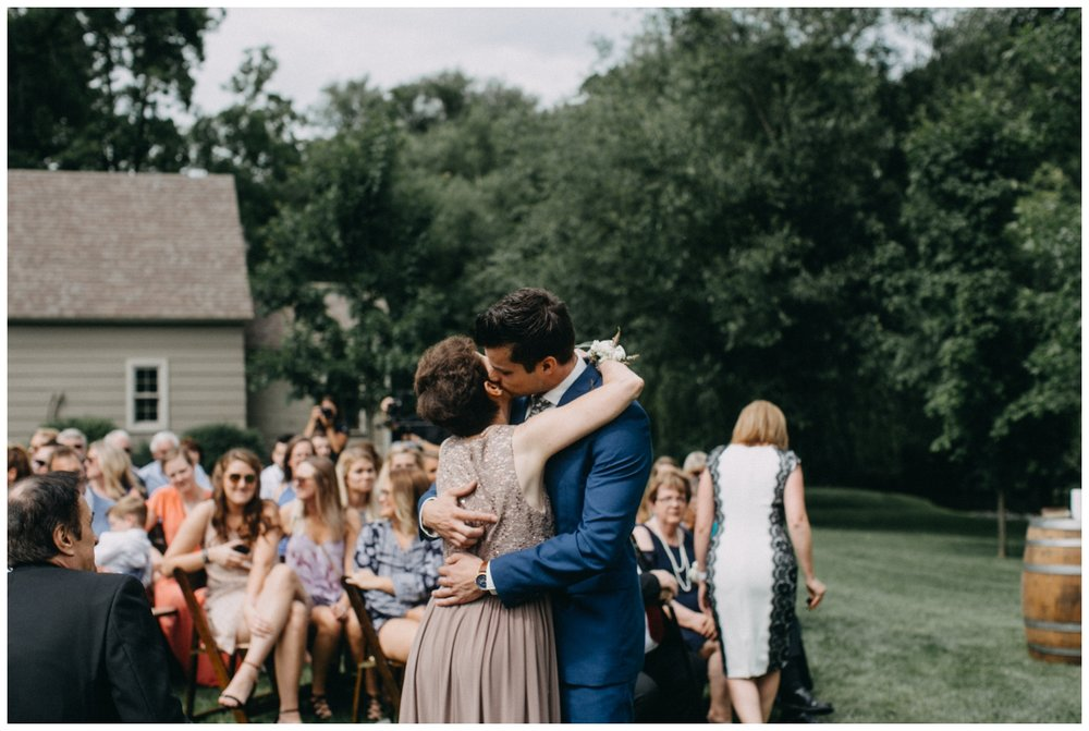 Groom with mom during wedding ceremony at Creekside Farm