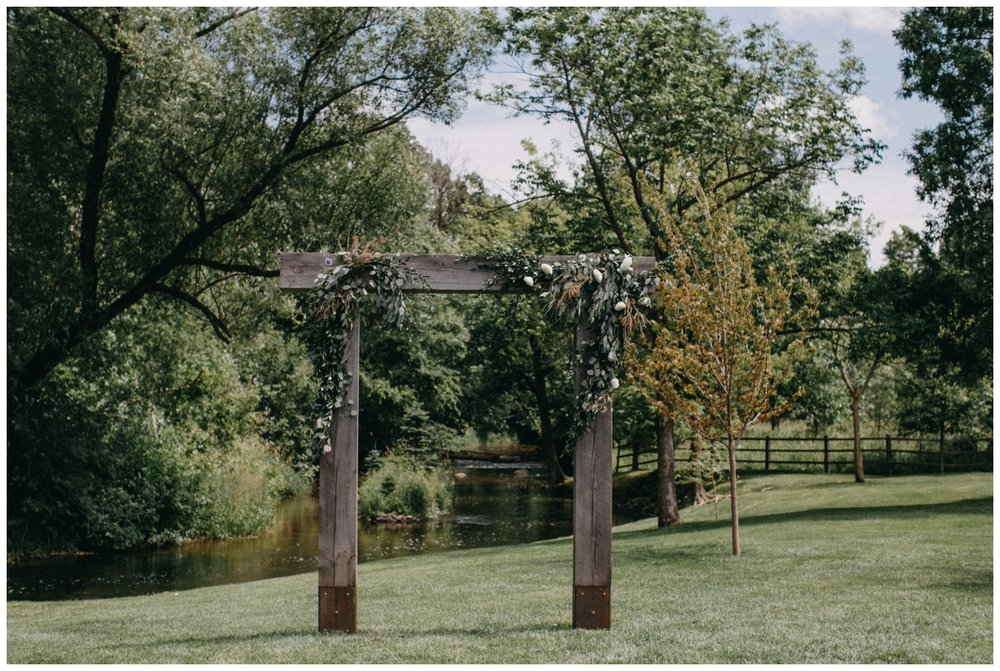Beautiful wooden wedding ceremony arch at Creekside Farm