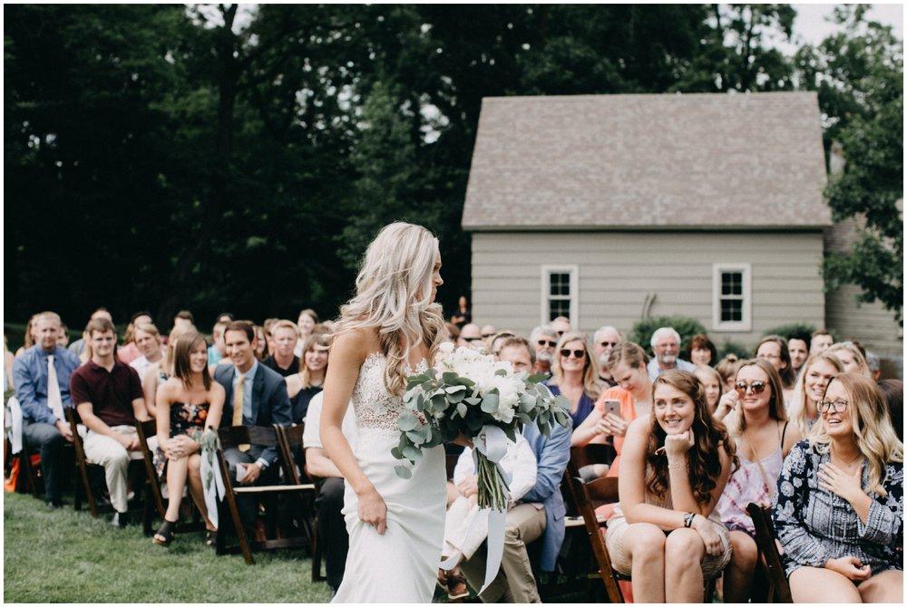 Emotional bride walking down aisle at Creekside Farm wedding ceremony
