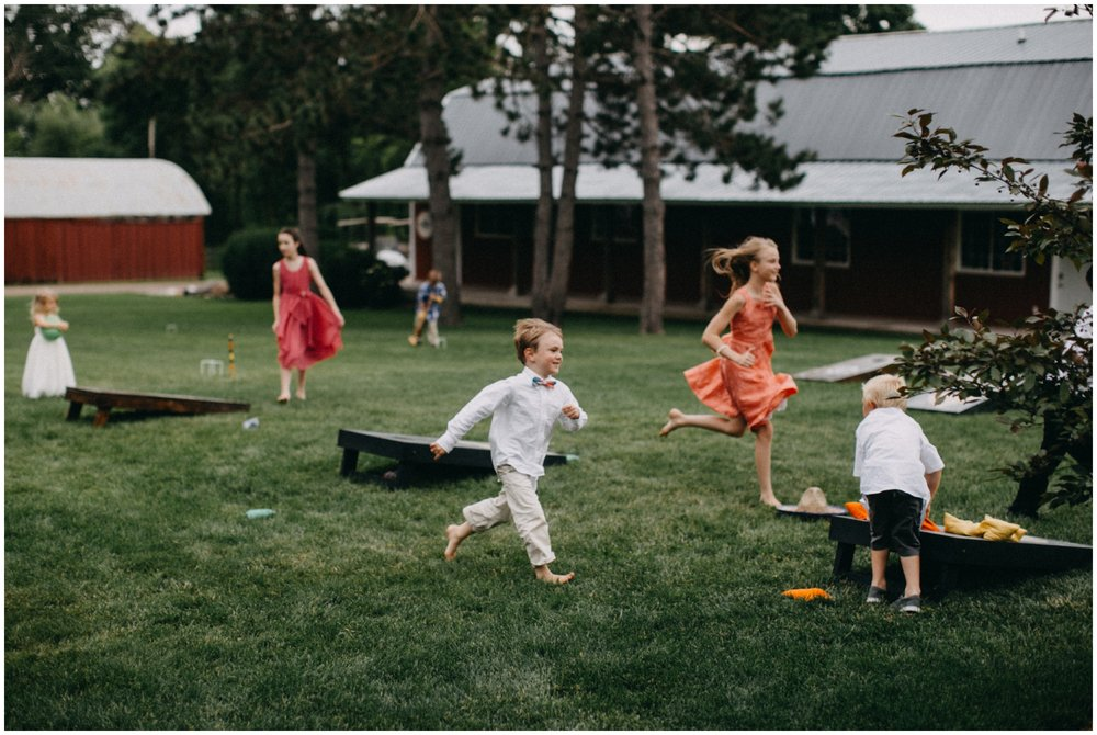 Kids playing during wedding reception at Creekside Farm
