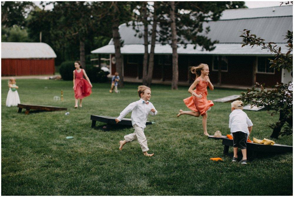 Kids playing during wedding reception at Creekside Farm