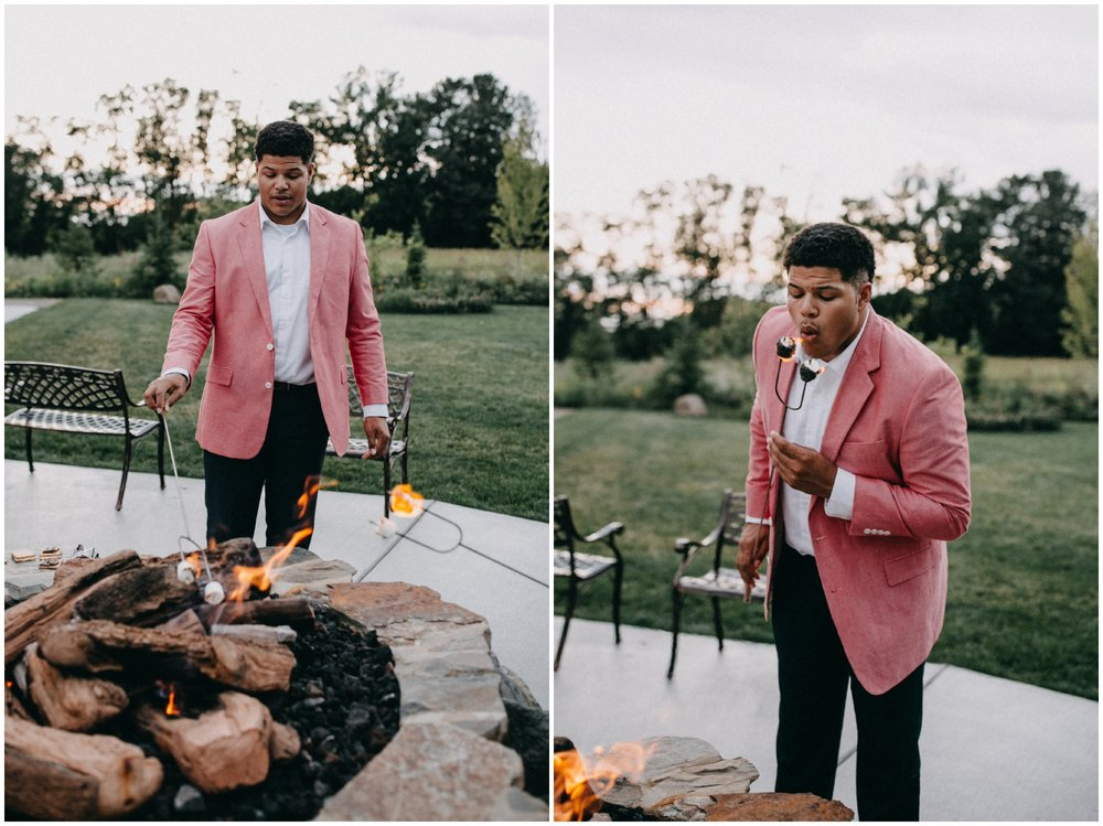 Wedding guests making s'mores during reception at Creekside Farm