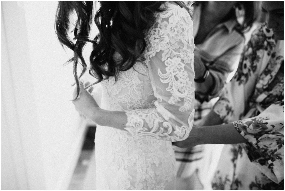 Long sleeved, lace wedding dress photographed by Brainerd MN photographer Britt DeZeeuw