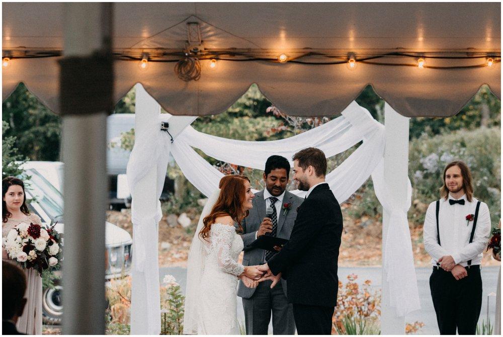 Rainy outdoor wedding ceremony at the Quarterdeck Resort