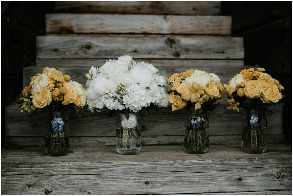 Yellow wedding bouquet at spring wedding on Gull Lake in Brainerd, MN