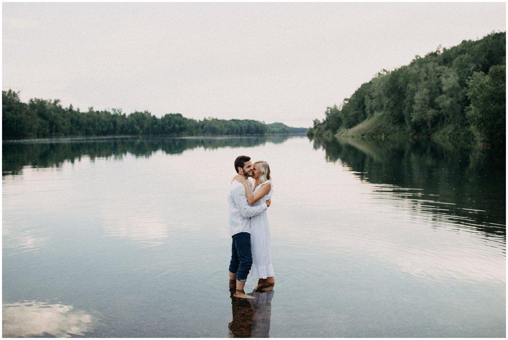 Engagement photo in the water by Britt DeZeeuw