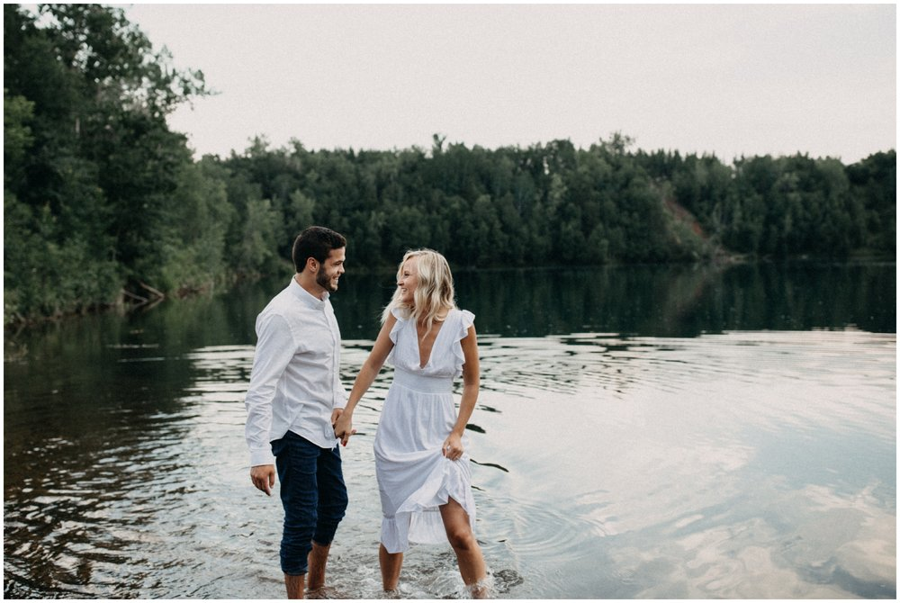 Candid and natural engagement session at the lake in Crosby Minnesota