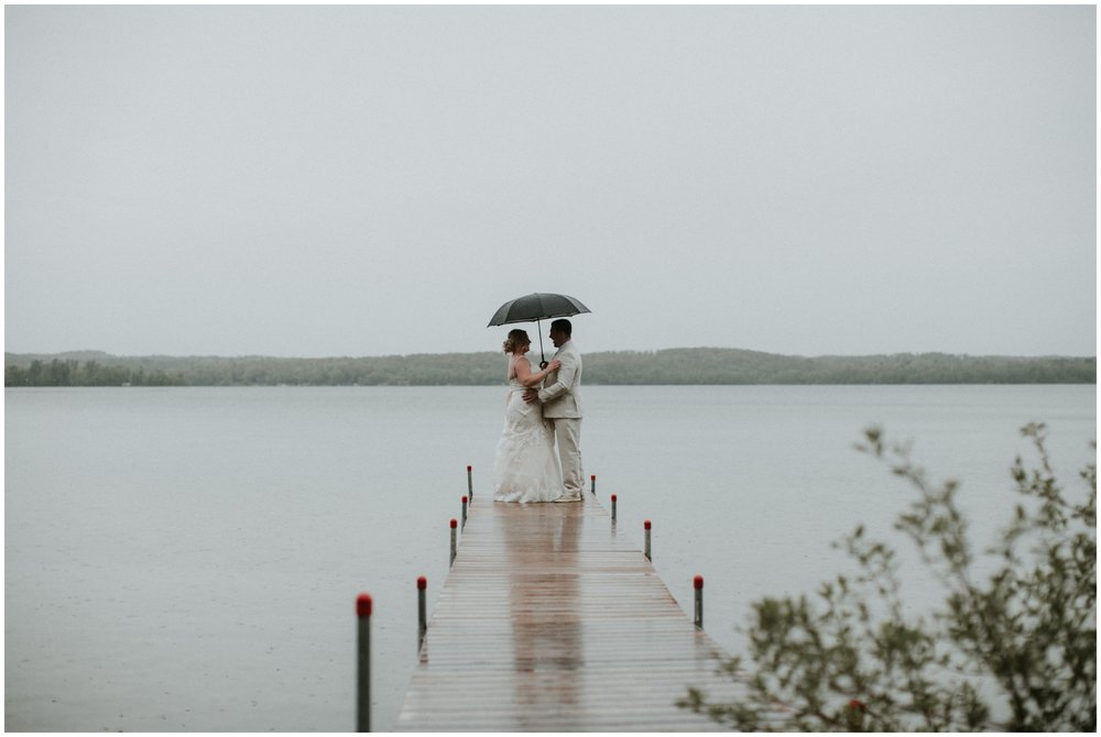 Rainy  spring wedding day on Gull Lake in Brainerd Minnesota